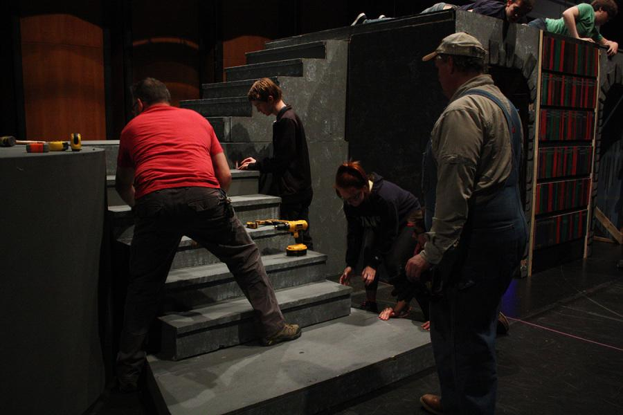 Members of theater help move the stage of Beauty and the Beast to the MISD Center for the Performing Arts.